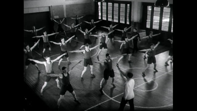 teenage boys take part in physical education lesson; 1955 - vest stock videos & royalty-free footage