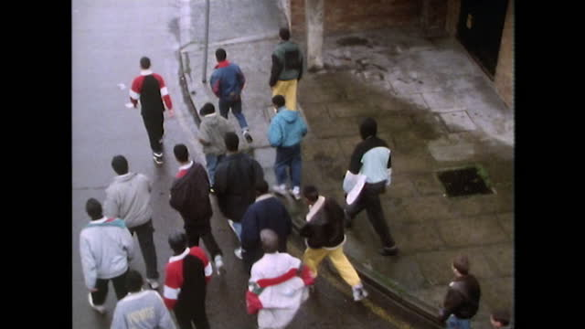 teenage boys walk along urban street; london, 1989 - design stock videos & royalty-free footage