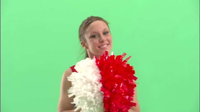 cu, teenage (16-17) cheerleader shaking pom poms in studio, portrait - one teenage girl only stock videos & royalty-free footage