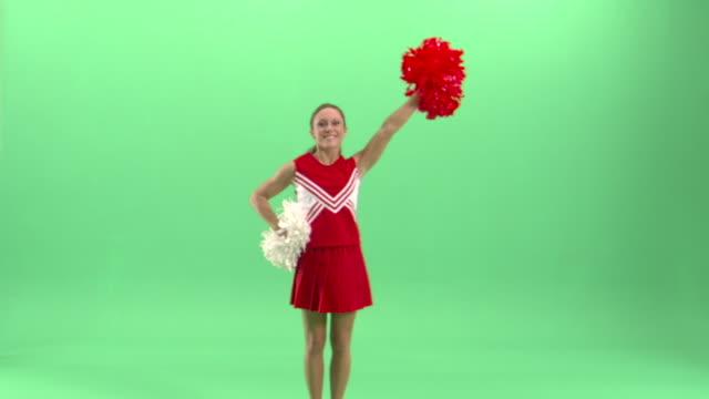 ws, teenage (16-17) cheerleader shaking pom poms in studio - pom pom stock videos & royalty-free footage