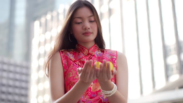 teenage chinese woman handed gold to camera for happy new year ,rich and lucky. - chinese culture stock videos & royalty-free footage