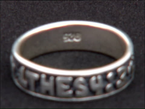 teenage christian girl takes school to court over uniform rules england int silver ring engraved with biblical chapter and verse which promotes... - biblical event stock videos & royalty-free footage