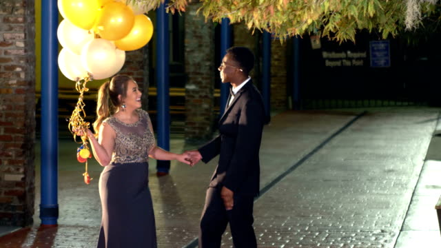 teenage couple after prom, kiss on cheek - teenage couple stock videos & royalty-free footage