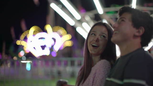 ms teenage couple at a carnival at night - teenage couple stock videos & royalty-free footage