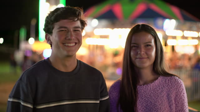 cu teenage couple at a carnival at night - teenagers only stock videos & royalty-free footage