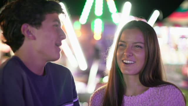 cu teenage couple at a carnival at night - teenage couple stock videos & royalty-free footage
