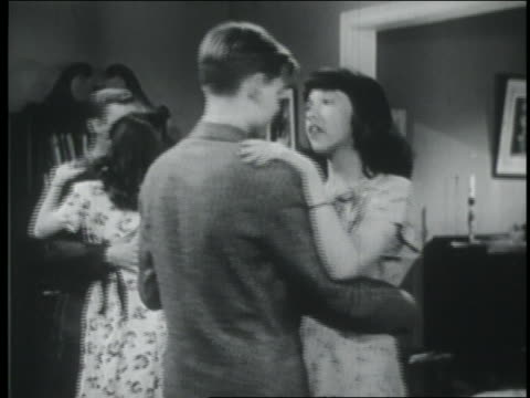 b/w 1946 teenage couple dancing at party + talking / they stop + walk off screen - teenage couple stock videos & royalty-free footage