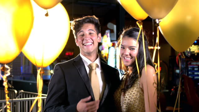 teenage couple having fun at prom, laughing at camera - 16 17 years stock videos & royalty-free footage