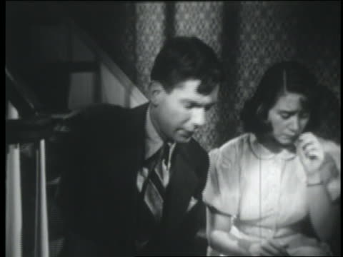 b/w 1951 teenage couple sitting on stairs / boy hands handkerchief to crying girl - teenage couple stock videos & royalty-free footage