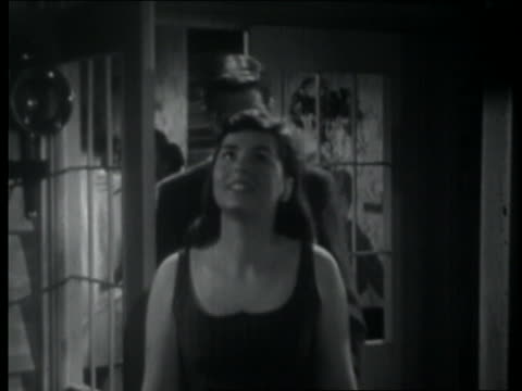 stockvideo's en b-roll-footage met b/w 1957 teenage couple standing on balcony + talking at night during party - 1957