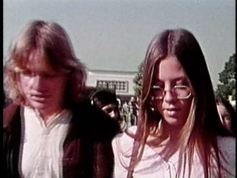 1973 cu teenage couple talking outdoors, los angeles, california, usa / audio - teenage couple stock videos & royalty-free footage
