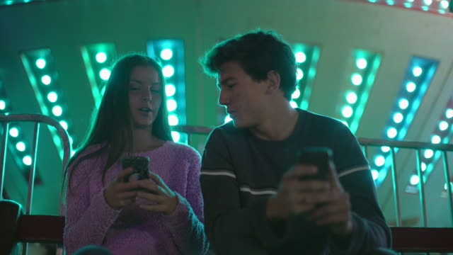 MS Teenage couple texting at night