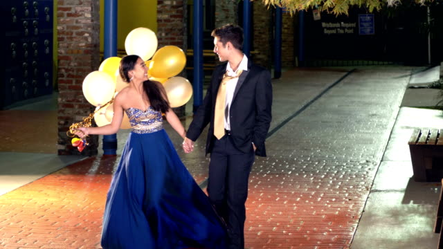 teenage couple walking together after prom - 16 17 years stock videos & royalty-free footage