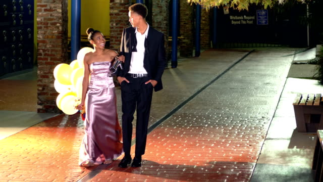 teenage couple walking together after prom - teenage couple stock videos & royalty-free footage