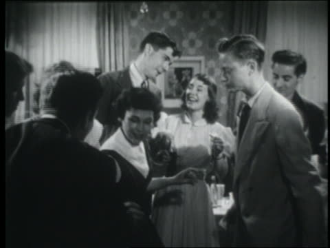 b/w 1951 teenage couples dancing at party - 1950 stock videos & royalty-free footage