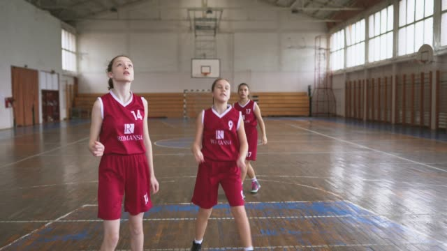 teenage female basketball team at training class - basketball ball stock videos & royalty-free footage