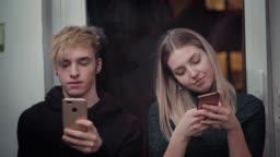 Teenage friends taking selfie in Christmas party