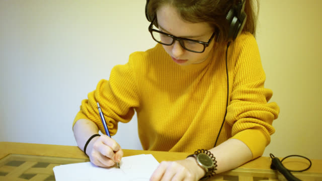teenage girl, 15 years old, doing homework - audio equipment stock videos & royalty-free footage