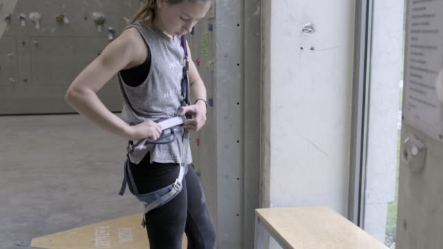 teenage girl  adjusting rock climbing ropes - safety equipment stock videos & royalty-free footage