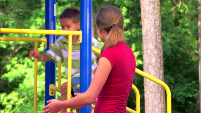 teenage girl and boy at a playground - see other clips from this shoot 1428 stock videos & royalty-free footage