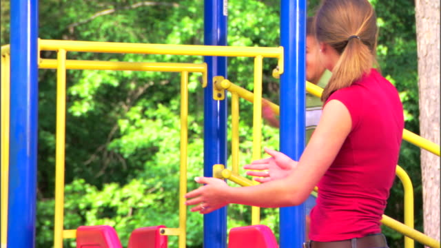 Teenage girl and boy at a playground