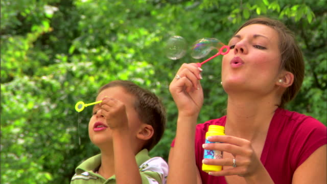 teenage girl and boy blowing bubbles - see other clips from this shoot 1428 stock videos & royalty-free footage