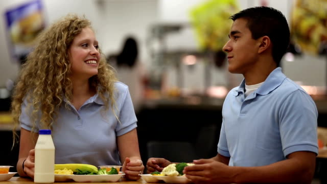 teenage girl and boy having fun discussion together at school - canteen stock videos & royalty-free footage