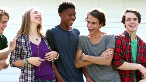 teenage girl and four guys in a row, laughing, pushing - teenage boys stock videos & royalty-free footage