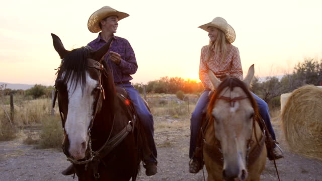 teenage girl and teenage boy riding horses - ranch stock videos & royalty-free footage