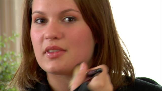 cu, pan, td, tu, teenage girl (14-15) applying make-up - one teenage girl only stock videos & royalty-free footage
