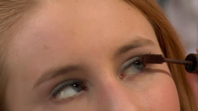 ECU, Teenage girl (14-15) applying make-up