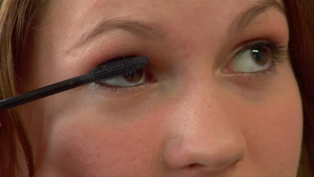 ecu, teenage girl (14-15) applying make-up - one teenage girl only stock videos & royalty-free footage