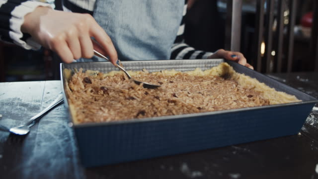 teenage girl arranging grated apple in dough - baking tray stock videos & royalty-free footage