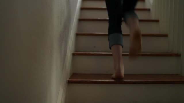 Teenage girl ascending staircase