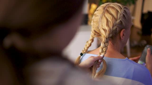 teenage girl braiding mother's hair - braided hair stock videos & royalty-free footage