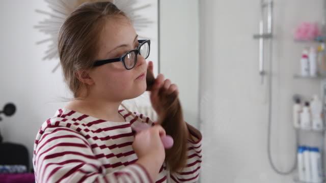 teenage girl brushing hair in the bathroom - brushing hair stock videos & royalty-free footage