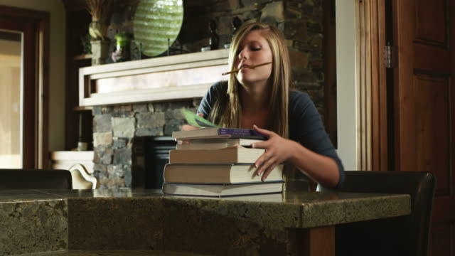 ms ds teenage (16-17) girl carrying stack of books and doing homework at home, american fork, utah, usa - american fork city stock videos & royalty-free footage