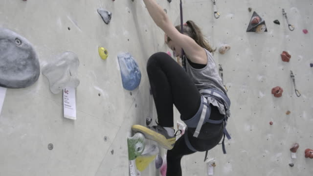 teenage girl climbing on indoor climbing wall - free climbing stock videos & royalty-free footage
