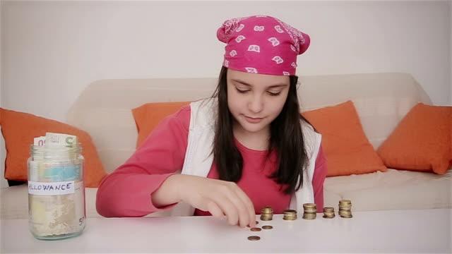 Teenage girl counting money