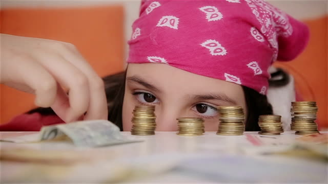 Teenage girl counting money,close up