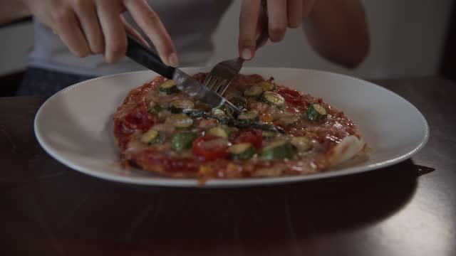 teenage girl cutting fresh homemade pizza - italian culture stock videos & royalty-free footage