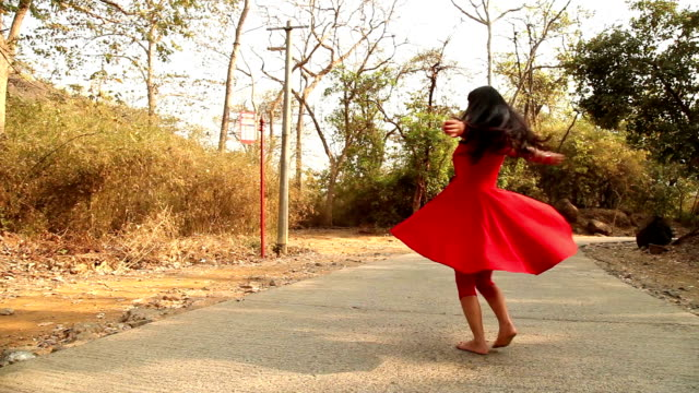teenage girl dancing and spinning on country road - dress stock videos & royalty-free footage