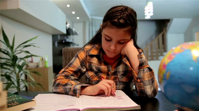 Teenage girl doing homework for school,dolly shot