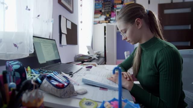 teenage girl doing homework in her room. - homework stock videos & royalty-free footage