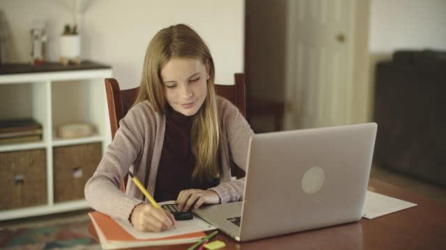teenage girl doing remote learning at home - distant stock videos & royalty-free footage