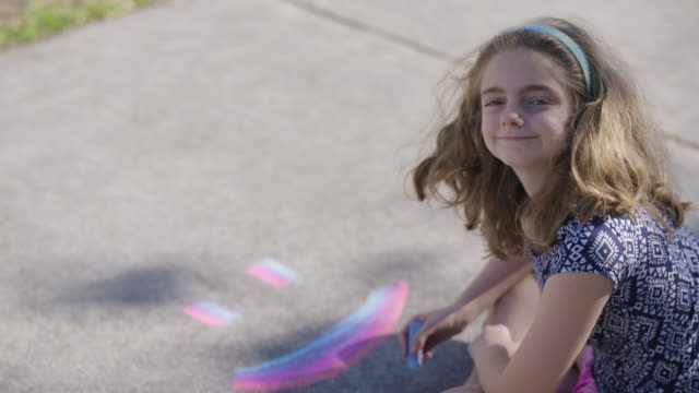 ms teenage girl draws a smiley face then smiles at the camera - symbols of peace stock videos & royalty-free footage