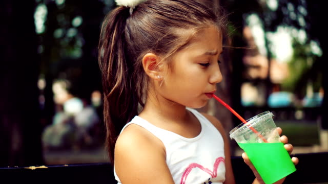 teenage girl drinking juice - straw stock videos & royalty-free footage