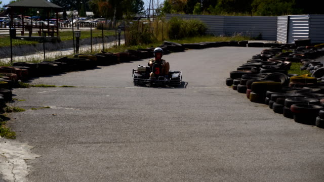 teenage girl drive a go-cart - go cart stock videos & royalty-free footage