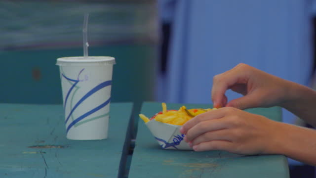 teenage girl eating french fries - one teenage girl only stock videos & royalty-free footage