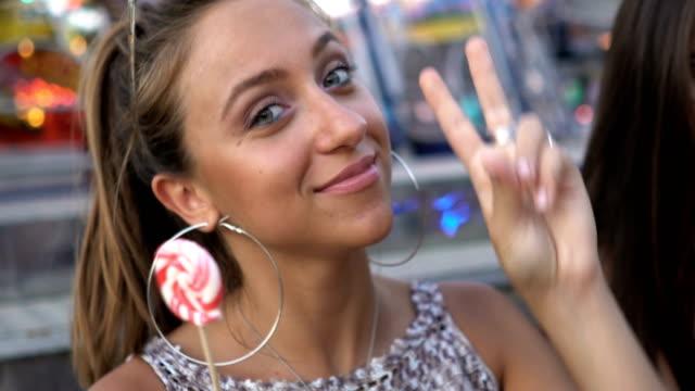teenage girl eats lollipop - lollipop stock videos & royalty-free footage